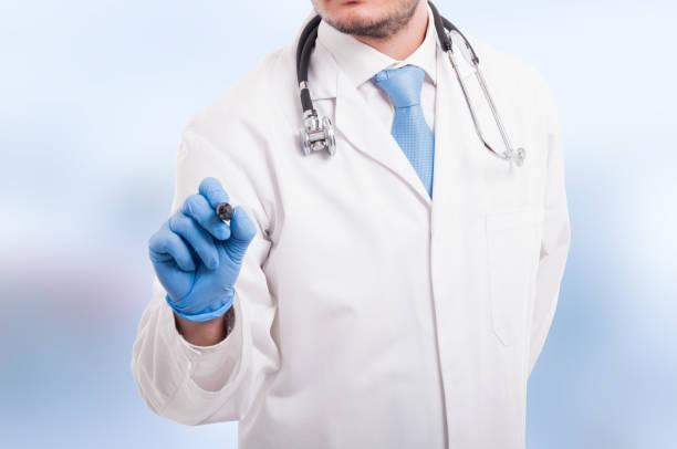 male doctor writing something with marker - hack rezepte stock-fotos und bilder