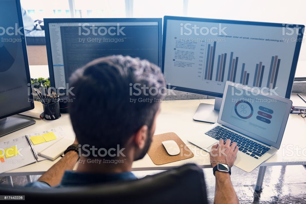 Male doing estimation on screen stock photo