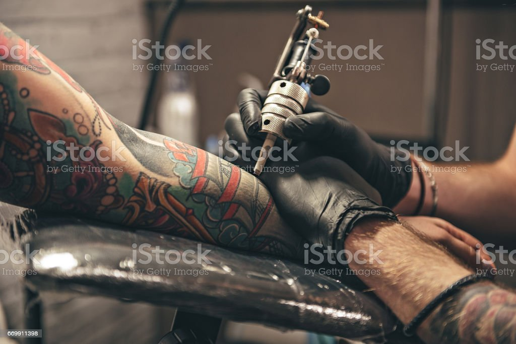 Male doing image on arm stock photo