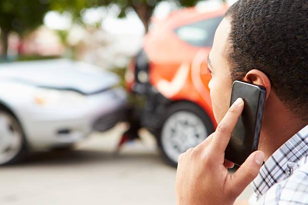 male driver making phone call after traffic accident - krockad bil bildbanksfoton och bilder