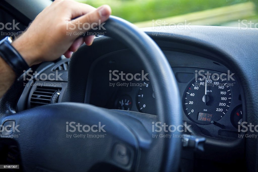 Male driver with hand on wheel inside car royalty-free stock photo