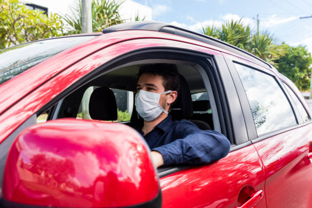 Male driver with protective mask stock photo