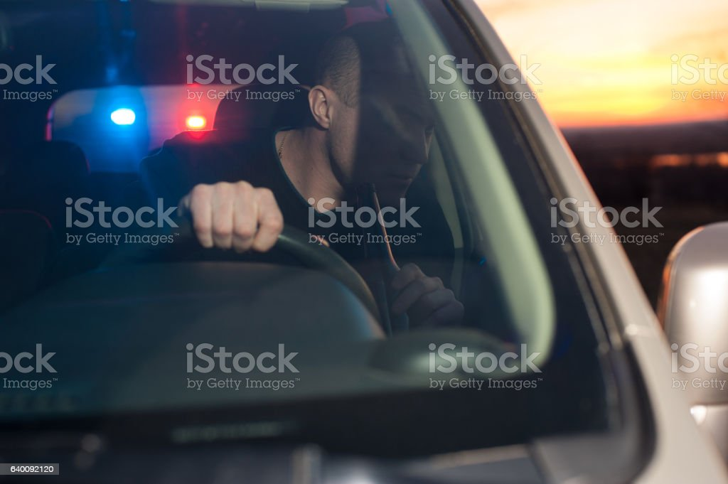 Male drunk driver chased by police stock photo