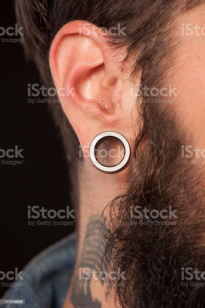 male ear with a ring stock photo