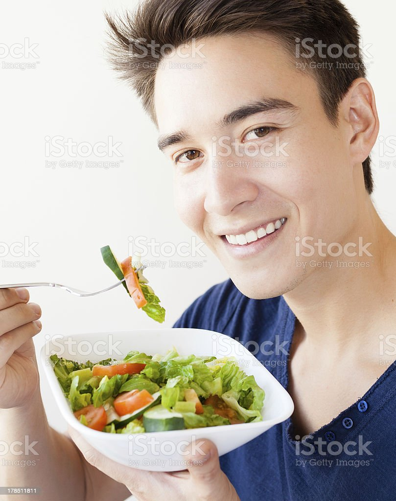 Male eating salad royalty-free stock photo