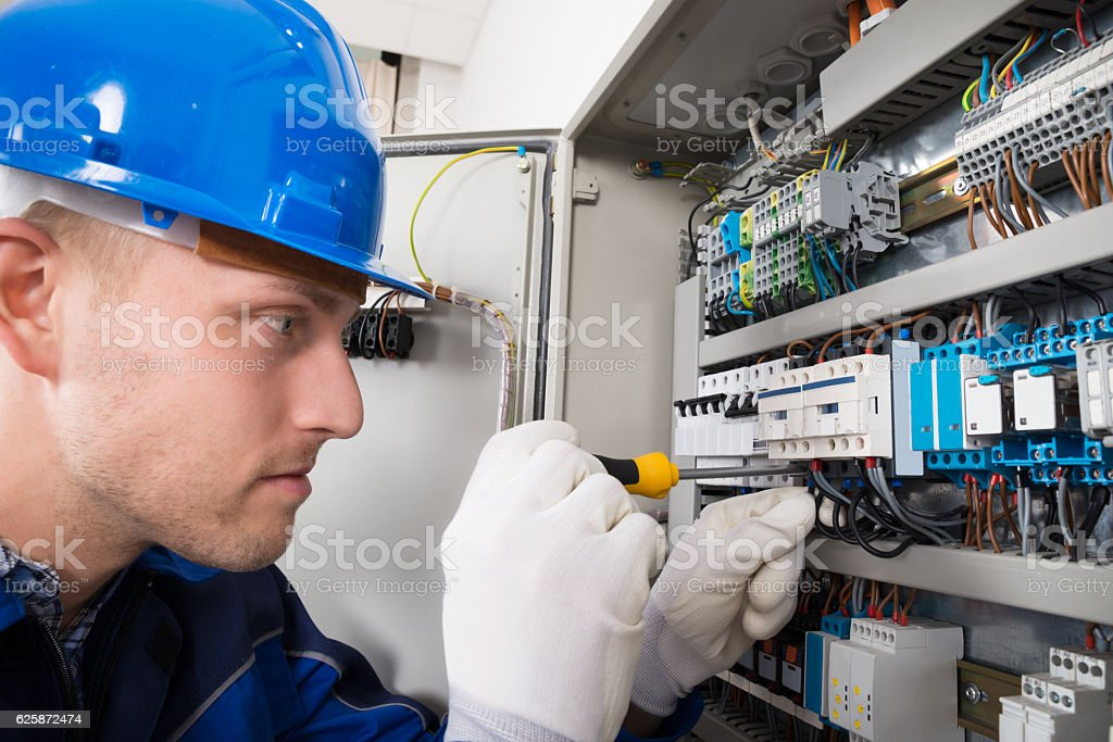 Male Electrician Examining Fusebox ストックフォト