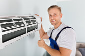 istock Male Electrician Gesturing Thumbs Up 832983620