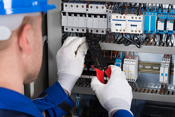 male electrician repairing fusebox - fuse box stock photos and pictures