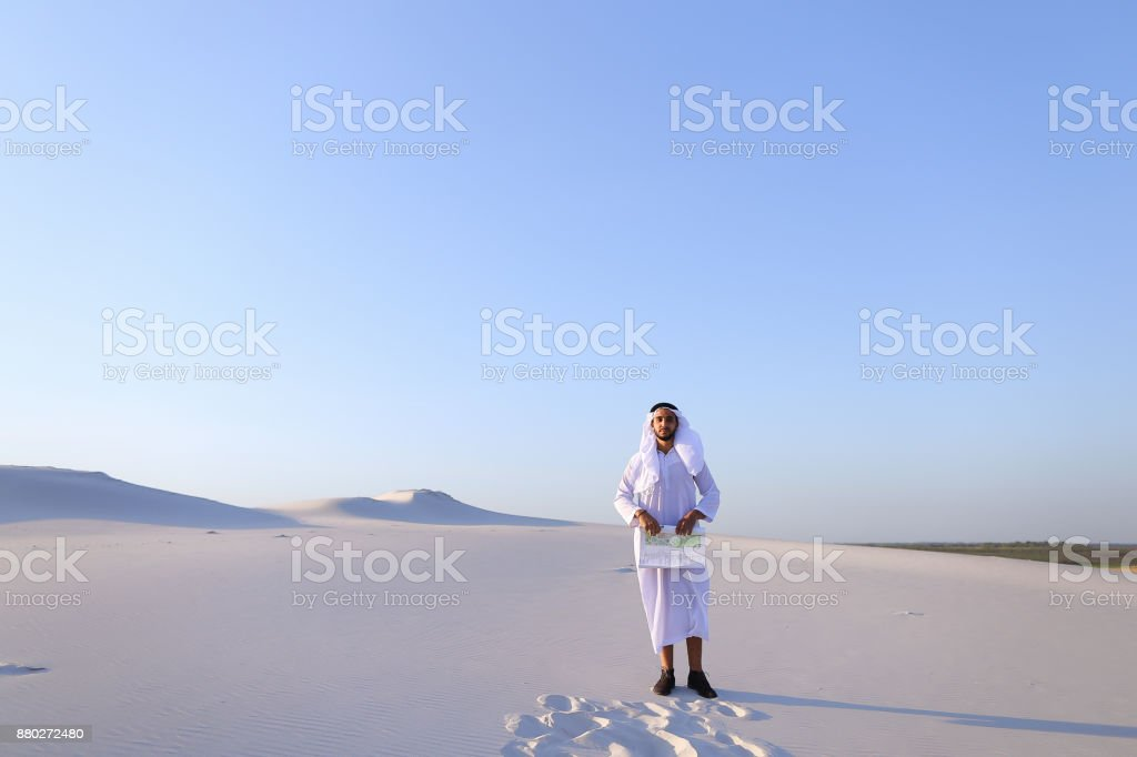 Male Emirati designer completes site survey for construction sit stock photo