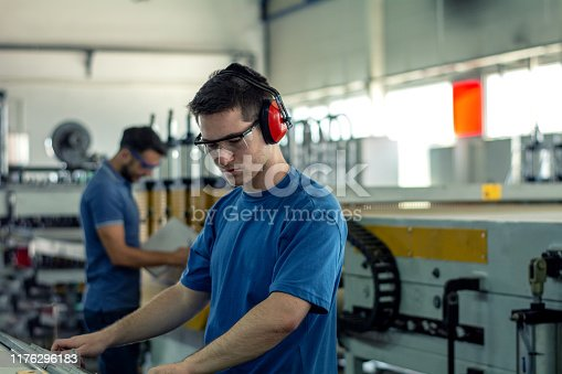 The CNC machine operator hand press the controller panel