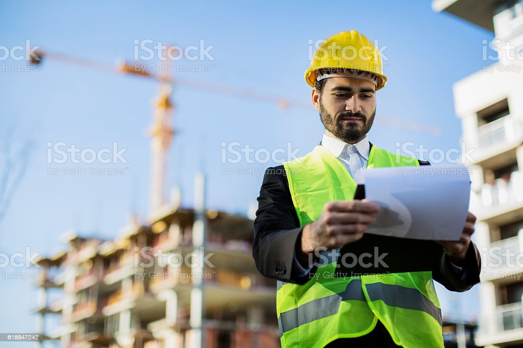 Male engineer looking at the papers stock photo