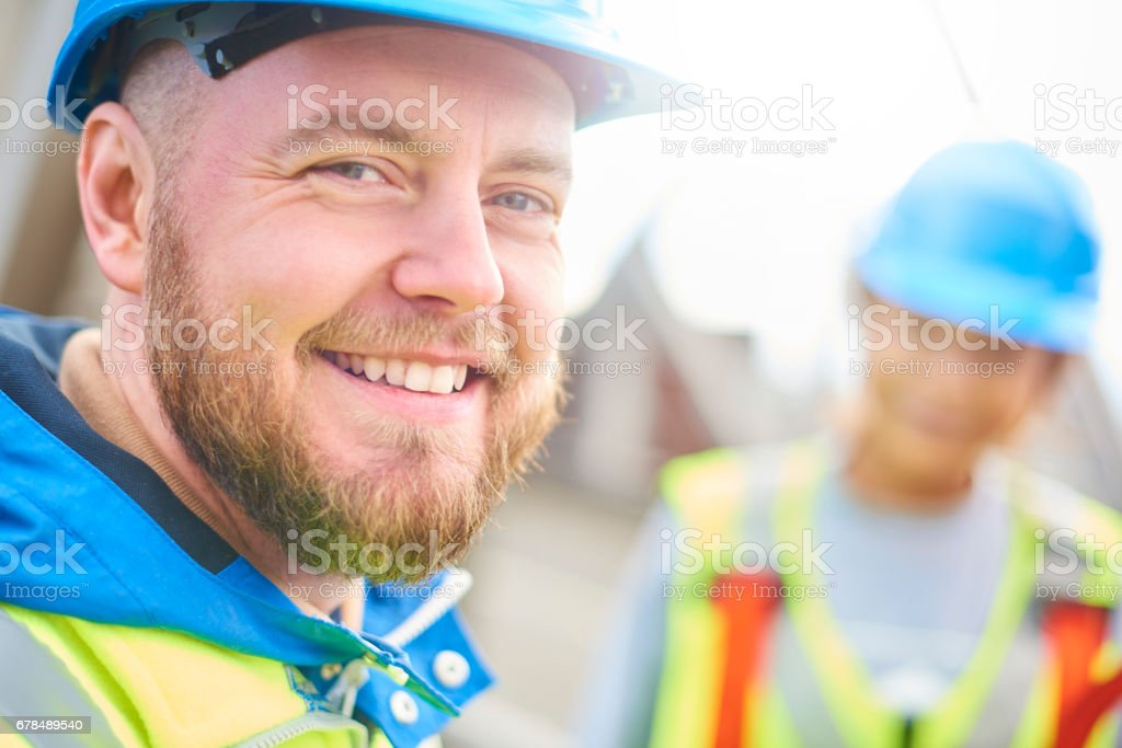 Male engineer smiles to camera stock photo
