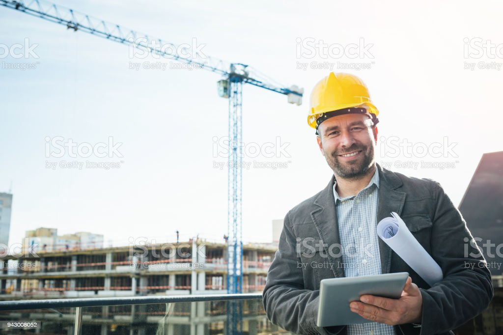 Male engineer smiling at camera stock photo