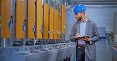 istock Male engineer using digital tablet in factory 1203164645