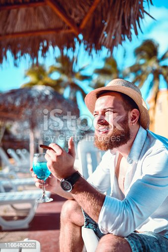Male Enjoying His Summer Vacation With Cigars And Cocktails