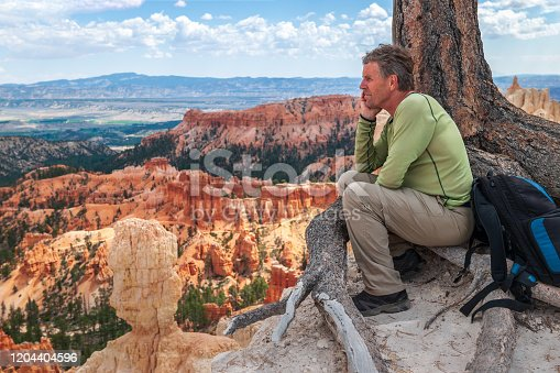 Male Enjoying on the edge of Bryce Canyon before Storm, Utah, USA,Nikon D3x