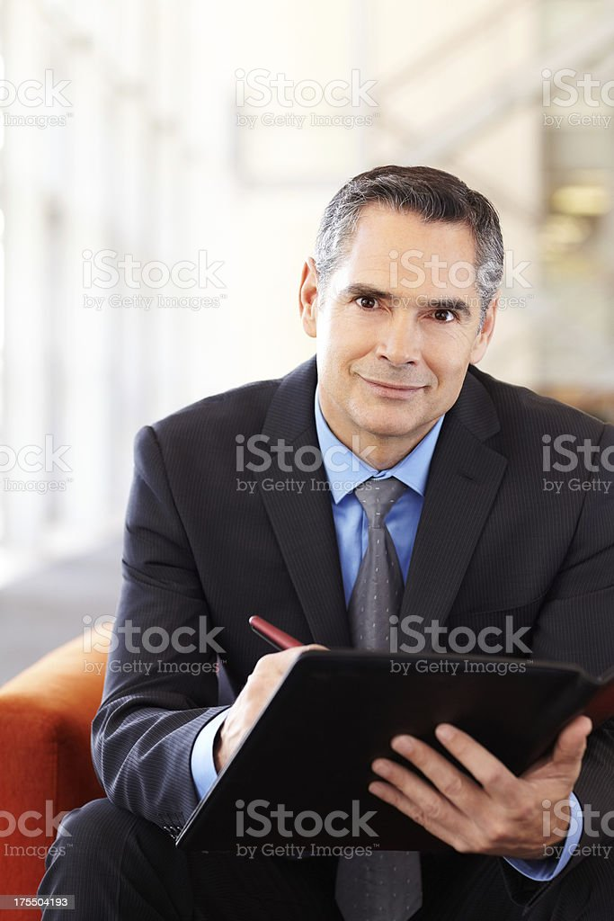 Male Entrepreneur Making Notes Before Meeting royalty-free stock photo