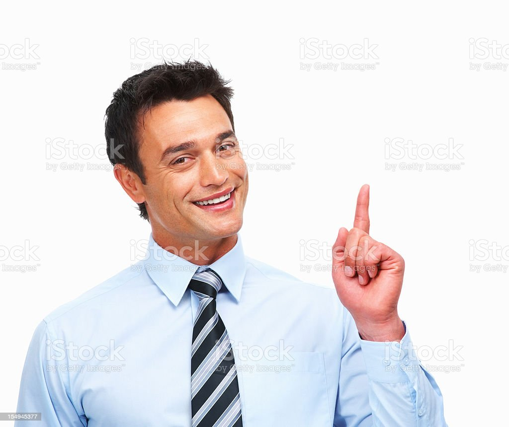 Male executive pointing at copyspace stock photo