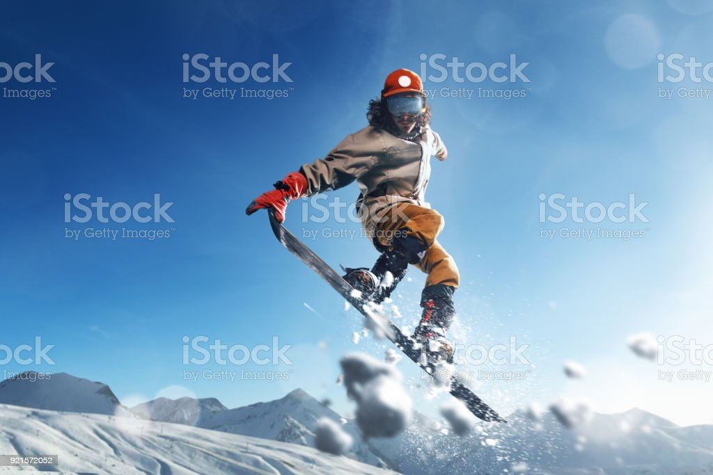 Male extreme freestyle snowboarder jump stock photo