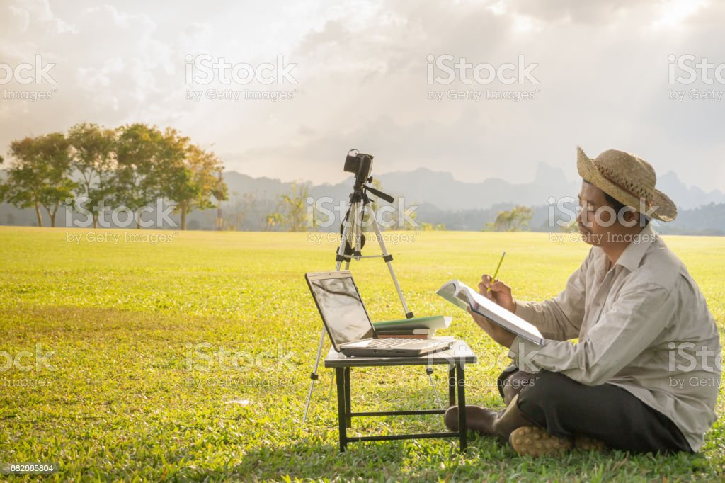 Male farmers are learning and planning to develop farms. stock photo