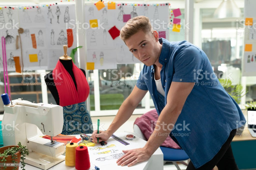 Male Fashion Designer Drawing Sketch On A Table In Design Studio Stock Photo Download Image Now Istock