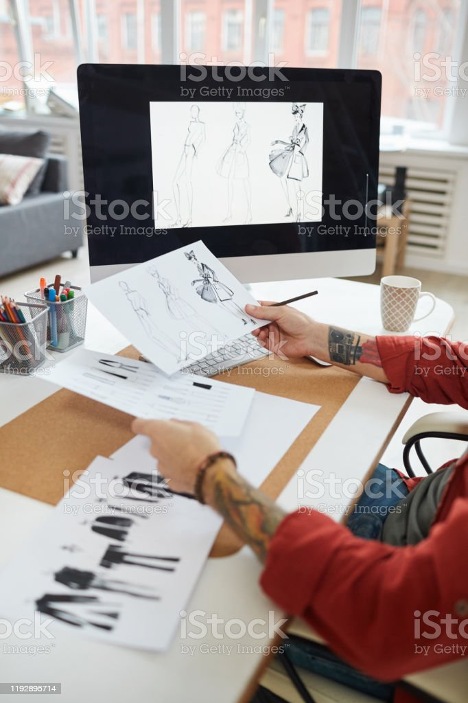 Male Fashion Designer Holding Sketches Stock Photo Download Image Now Istock