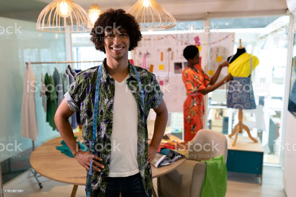 Male Fashion Designer Standing With Hands On Hip In Design Studio Stock Photo Download Image Now Istock