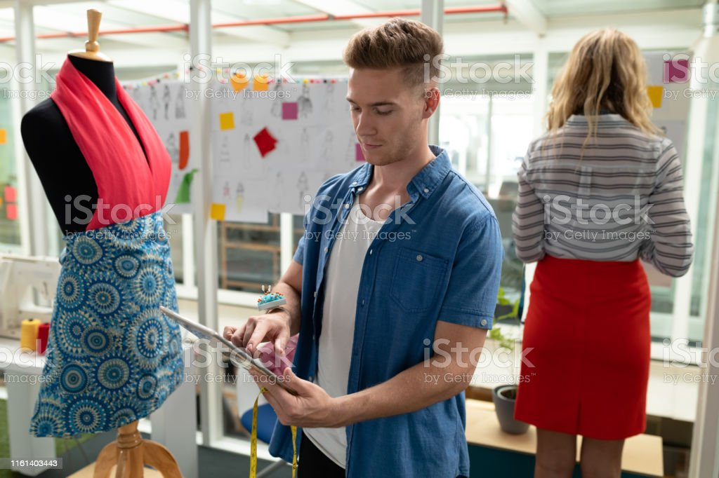 Male Fashion Designer Using Digital Tablet In Design Studio Stock Photo Download Image Now Istock