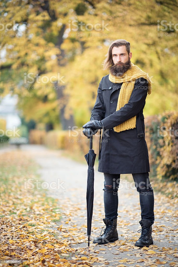 Male Fashion, Fall Colors, Man with Beard and Umbrella stock photo