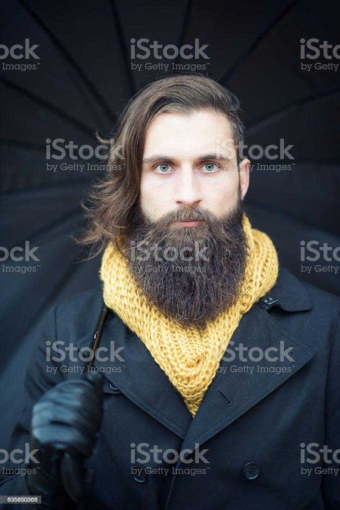 Male Fashion, Man with Beard and Umbrella stock photo