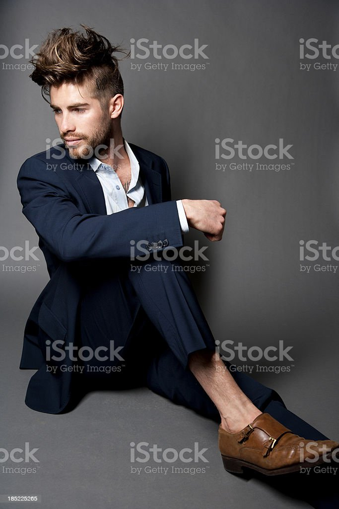 Male Fashion Model on grey textured background royalty-free stock photo