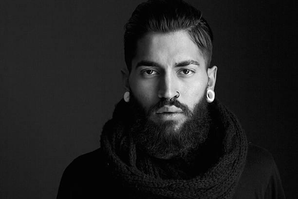 Male fashion model with beard stock photo