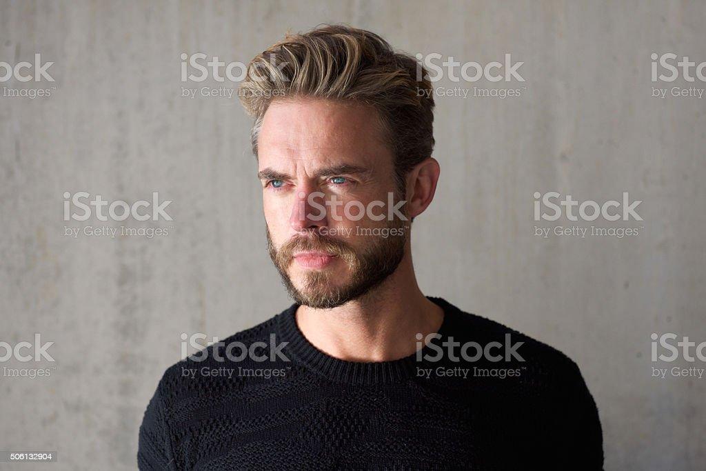 Male fashion model with beard staring stock photo