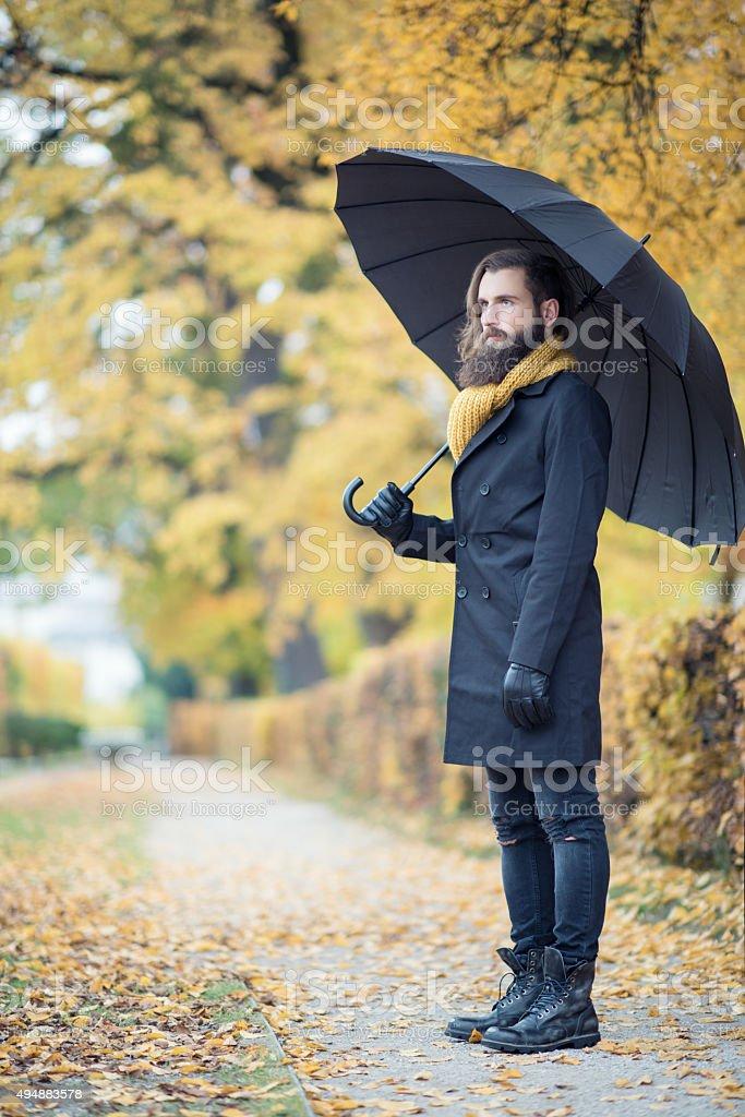 Male Fashion Model with Umbrella, Fall Colors stock photo