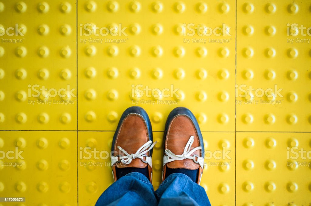 Male feet standing on blind pedestrian walking stock photo