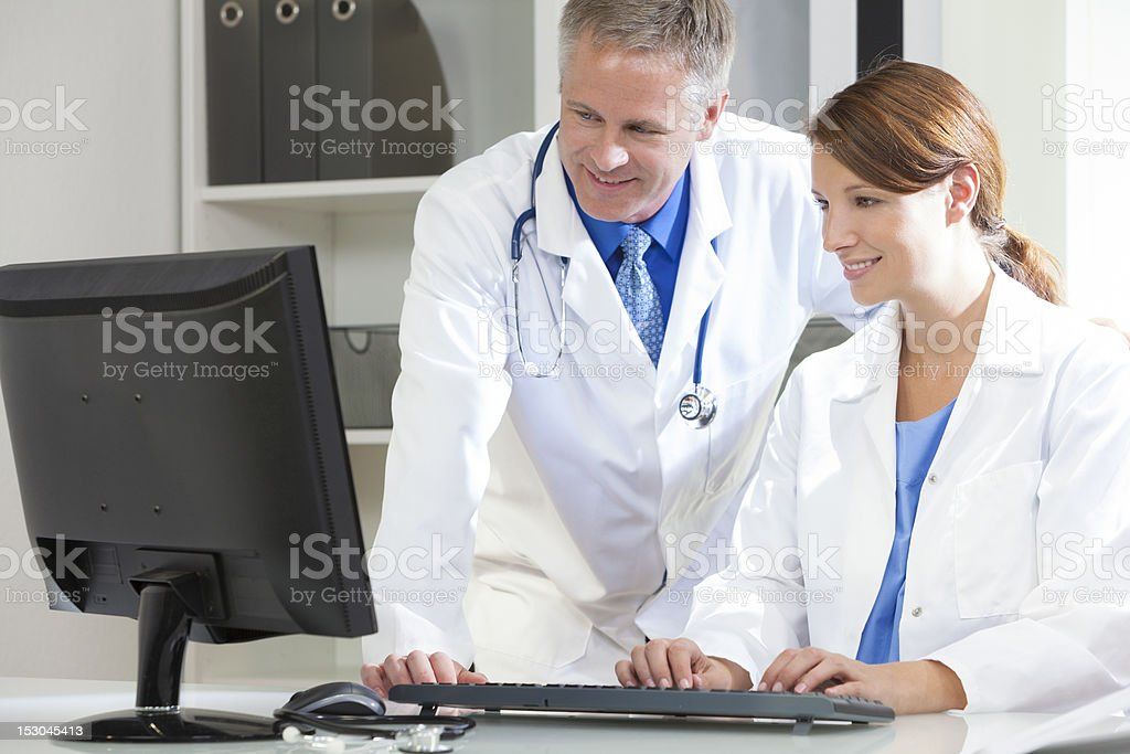 Male Female Hospital Doctors Using Computer royalty-free stock photo