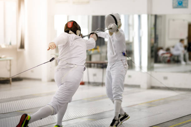 Male fencing athletes playing stock photo