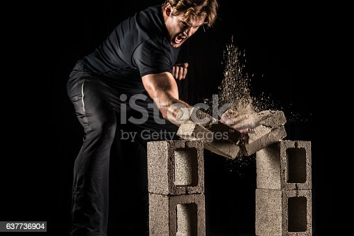 istock Male Fighter Breaking Bricks 637736904
