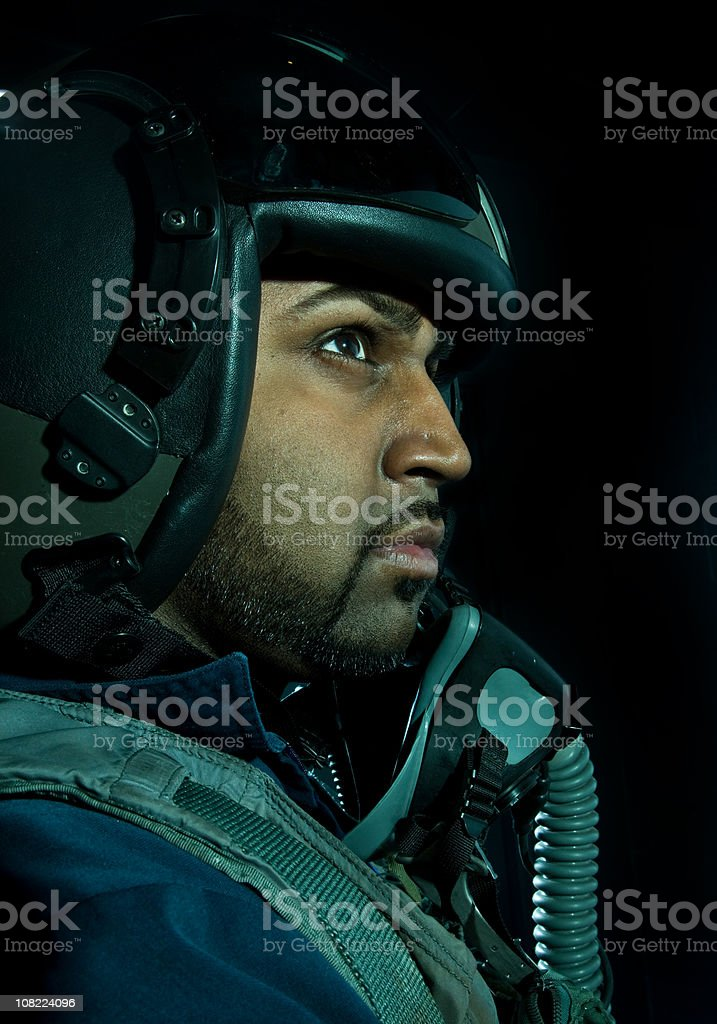 Male Fighter Plane Pilot Wearing Helmet and Oxygen Mask stock photo