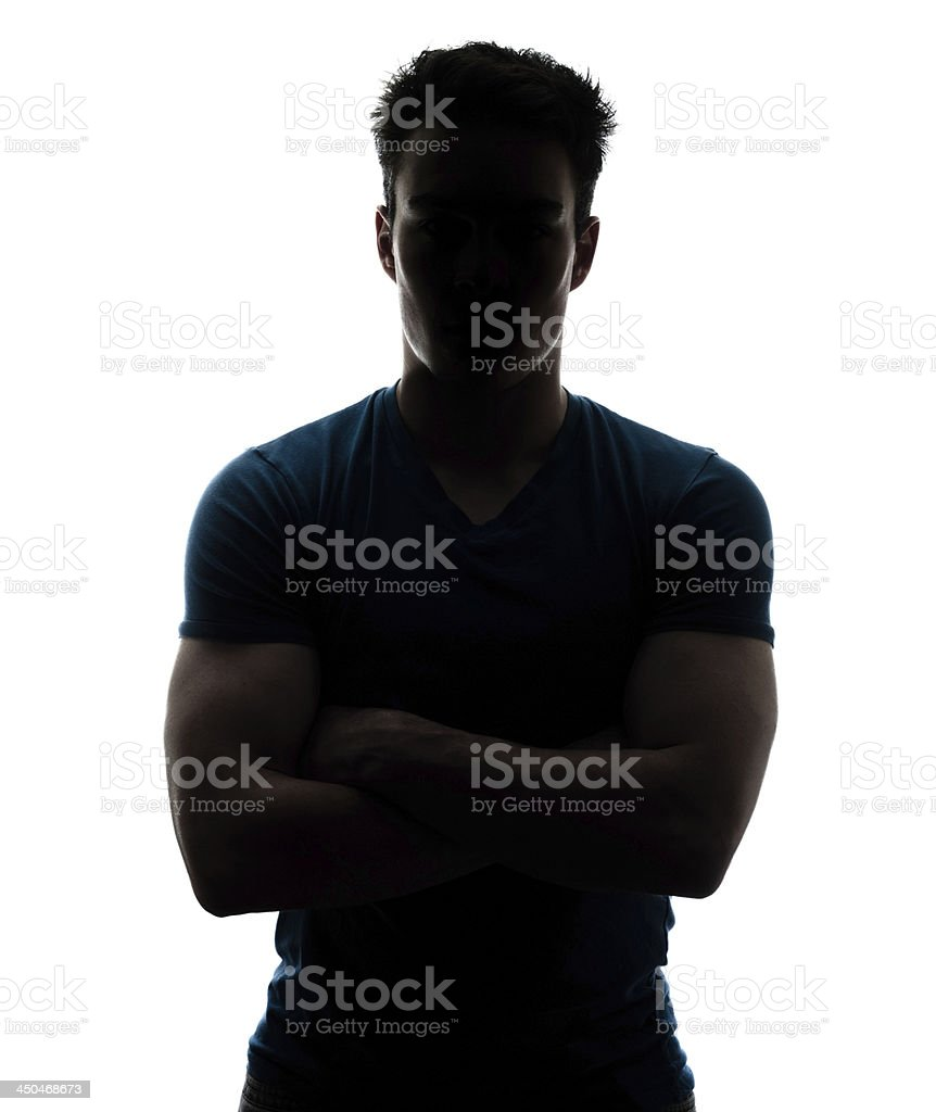 Male figure in silhouette looking at the camera stock photo