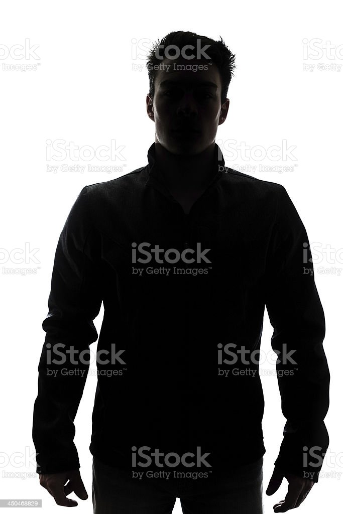 Male figure in silhouette wearing a vest stock photo