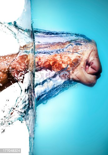 istock Male Fist Hitting Water 177048324