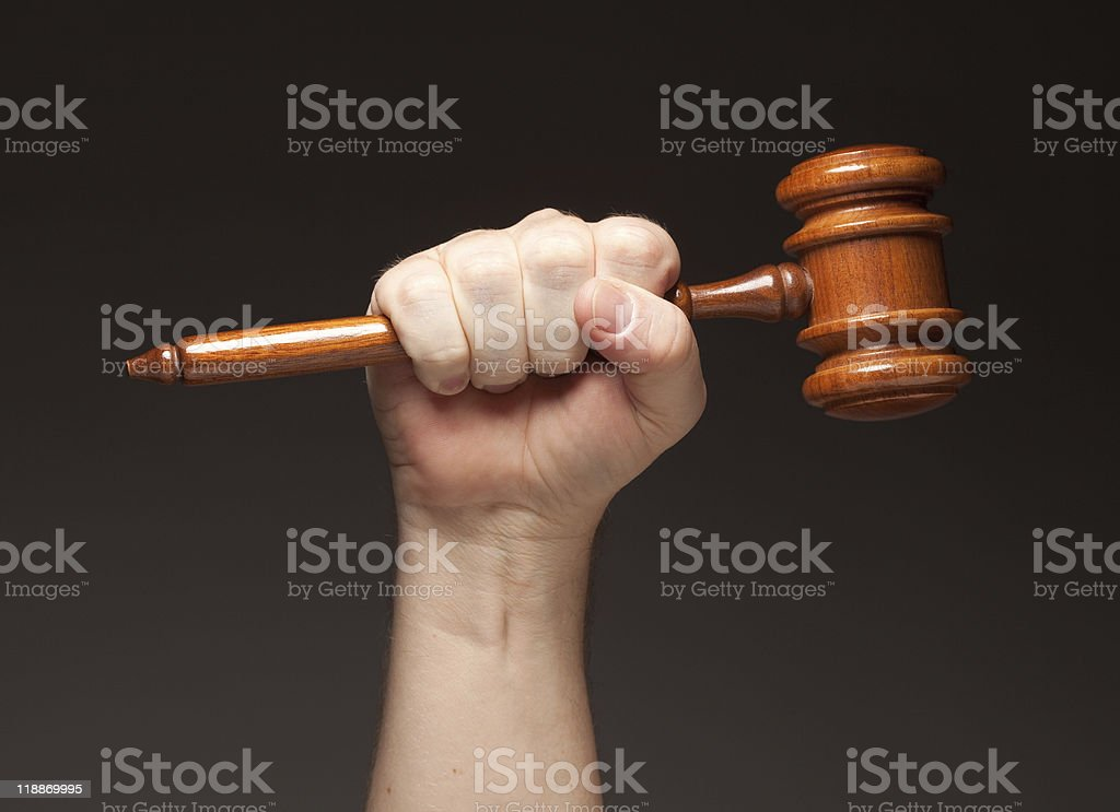 Male Fist Holding Wooden Gavel royalty-free stock photo