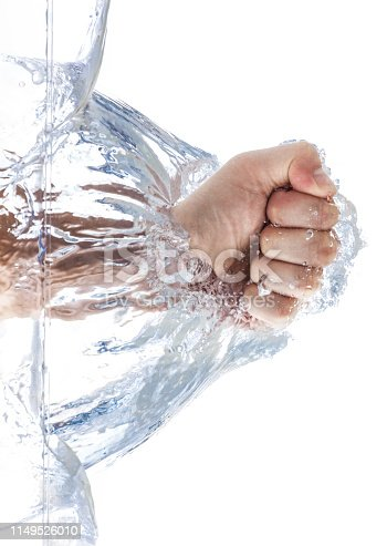 A male fist is smashing the water with waves and bubbles. Isolated on white background.