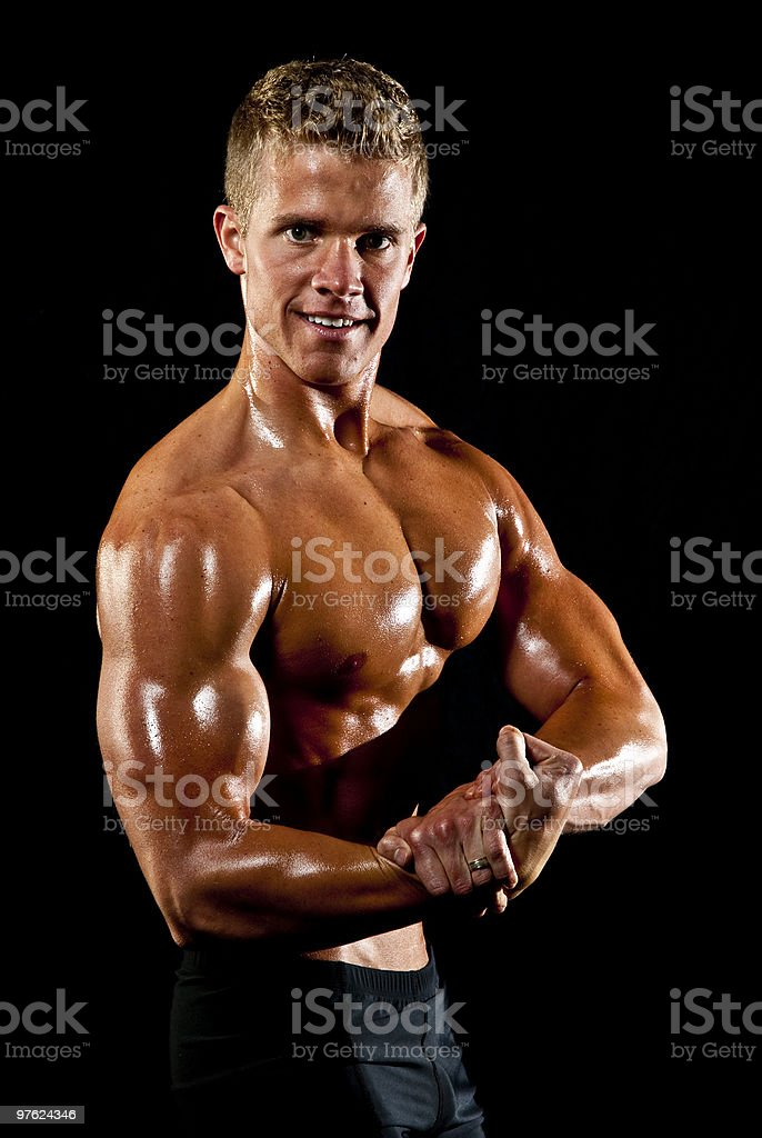 Male Fitness Model Flexing Right Arm Muscles royalty-free stock photo