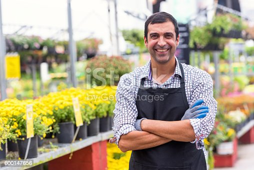 istock Male Florist working at a nursery 600147656
