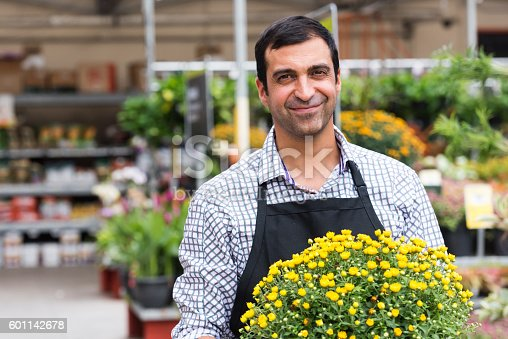 istock Male Florist working at a nursery 601142678
