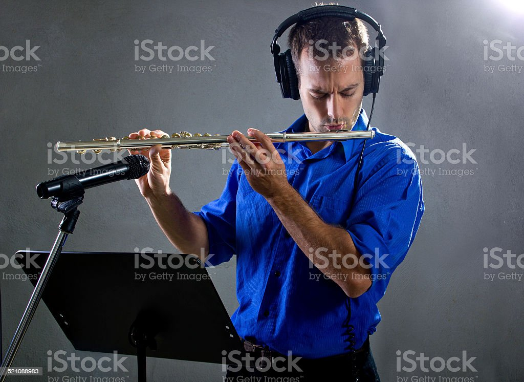 Male Flute Player in a Recording Studio stock photo