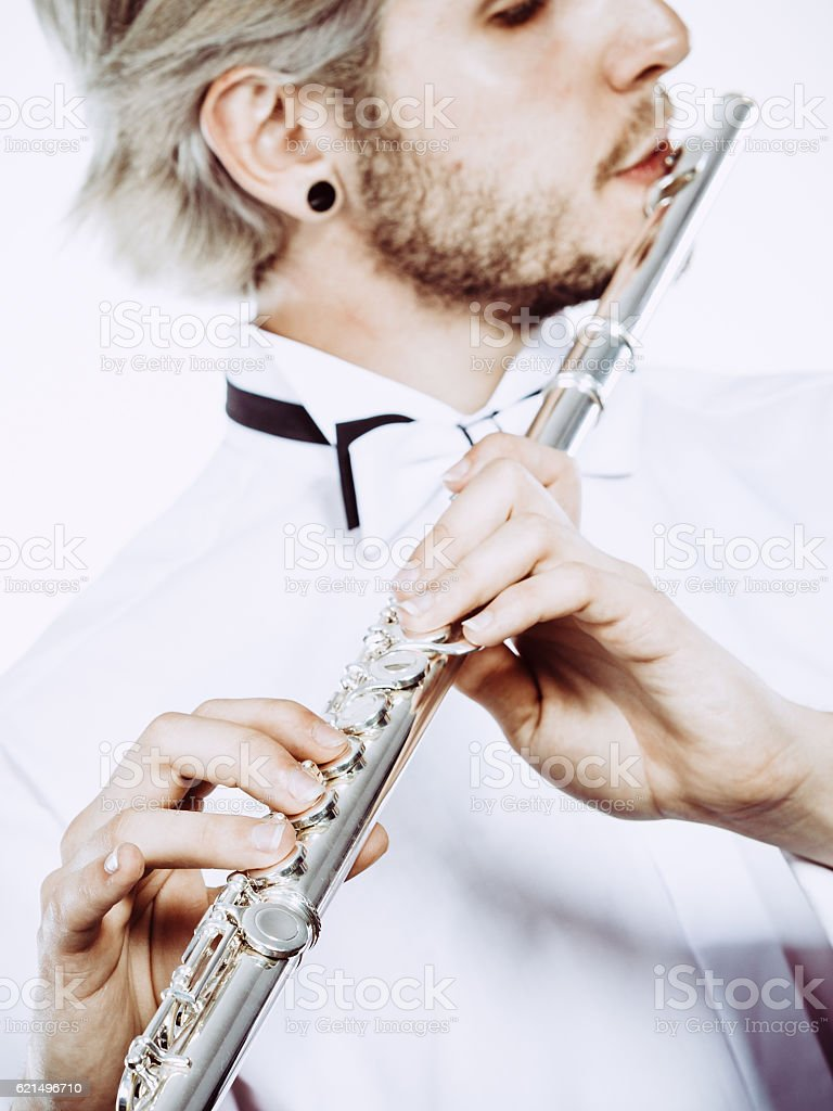 Male flutist playing his flute closeup photo libre de droits