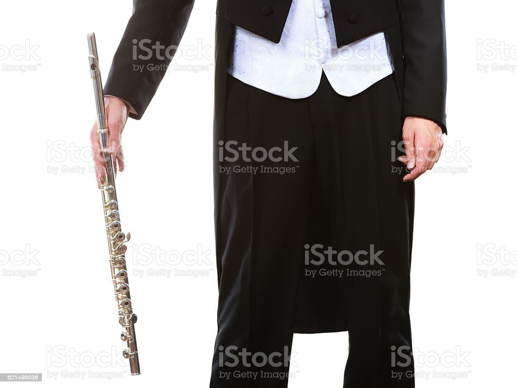 Male flutist wearing tailcoat holds flute foto stock royalty-free